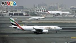 In this Tuesday April 20, 2010 file photo, an Emirates airline passenger jet taxis on the tarmac at Dubai International airport in Dubai, United Arab Emirates. . (AP Photo/Kamran Jebreili, File)
