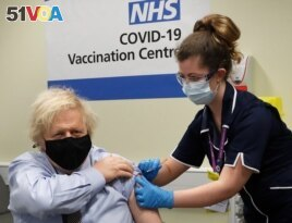 FILE - Britain's Prime Minister Boris Johnson receives the first dose of the AstraZeneca vaccine administered by nurse and Clinical Pod Lead, Lily Harrington at St.Thomas' Hospital in London, March 19, 2021.