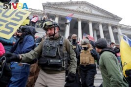 FILE - Members of the Oath Keepers are seen among supporters of U.S. President Donald Trump at the U.S. Capitol during a protest in Washington, Jan. 6, 2021.