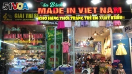 FILE - A shop in Vietnam sells