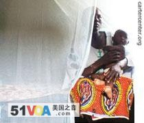 A Nigerian mother with an insecticide-treated bed net