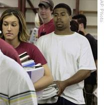 Students at Kutztown University in Pennsylvania wait in line to sell back used textbooks at a local bookstore