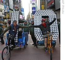 Numbers arrive, on pedicabs, to be placed atop Times Square in New York for the New Year's Eve ball drop welcoming 2010