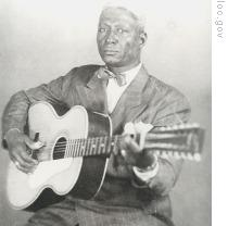 Huddie 'Lead Belly' Ledbetter with his 12-string guitar in a 1940s publicity photo