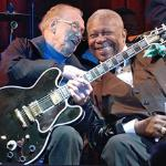 Les Paul, left, and B.B. King performing in 2003. Les Paul is holding B.B. King's guitar, Lucille.