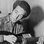 Woody Guthrie sang songs describing the conditions at the farm worker camps that he was visited.