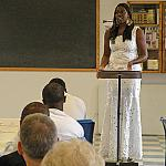 Scholarship winner Tomi Dare speaks to inmates