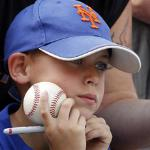 New York Mets fan Stephen LaGrua, 8, waits to get an autograph signed before an opening day baseball game between the Florida Marlins and the Mets in Miami, Friday, April 1, 2011