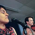 Irish violinist Colm O'Riain and his wife, Pireeni Sundaralingam, a Sri Lankan Tamil poet, performing together.